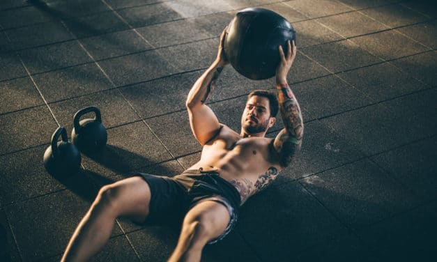 Use a medicine ball to build lean abs